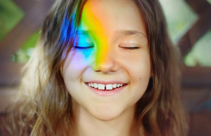 Girl with a rainbow on her face