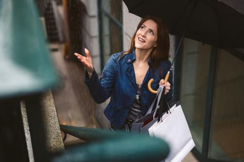 Woman with umbrella walking in rain