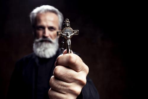 Priest holding a cross