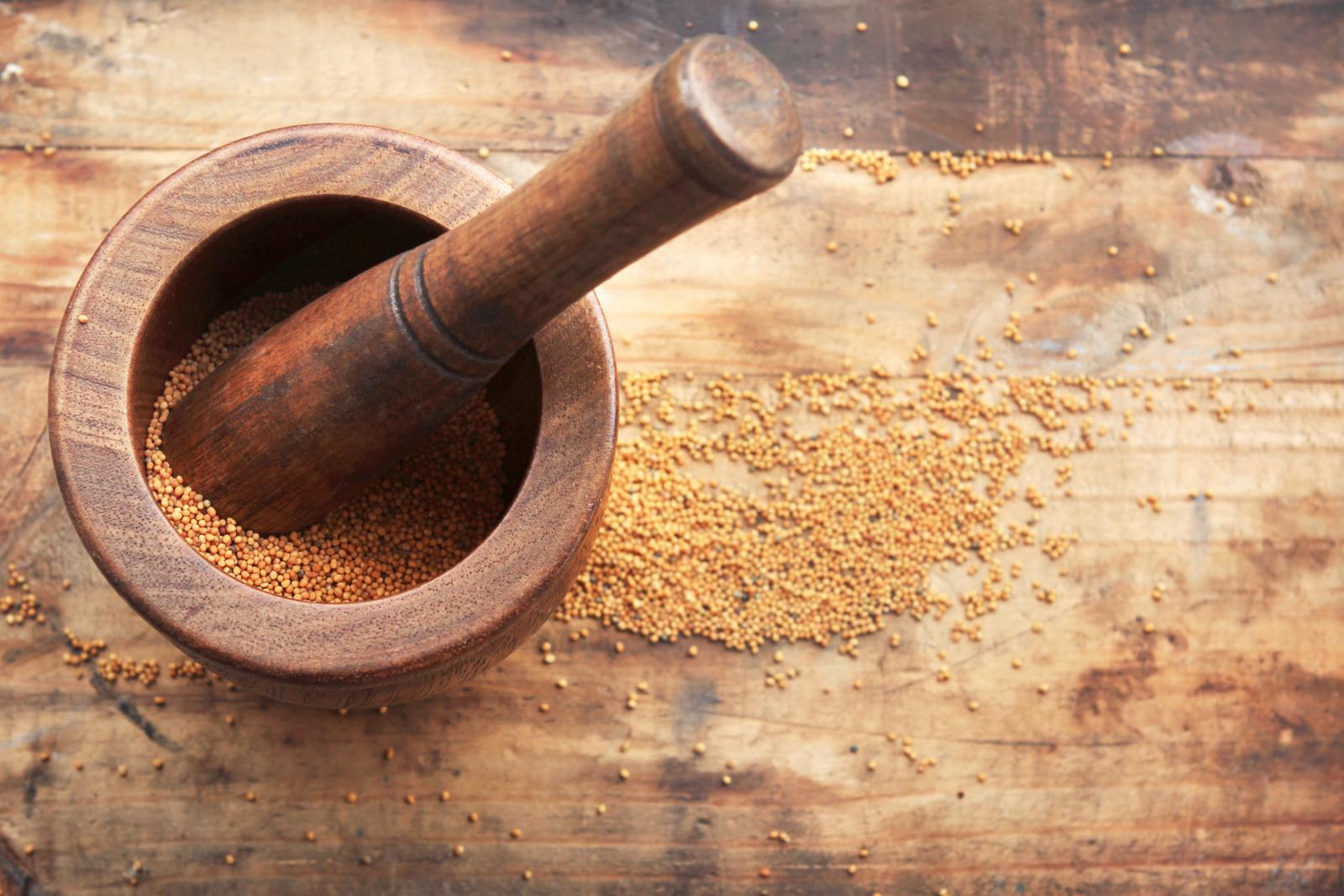 Mortar and pestle with mustard seeds