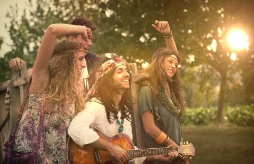 Hippies Dancing and Playing Guitar
