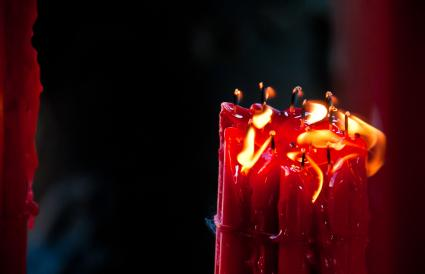 Bright red light candles