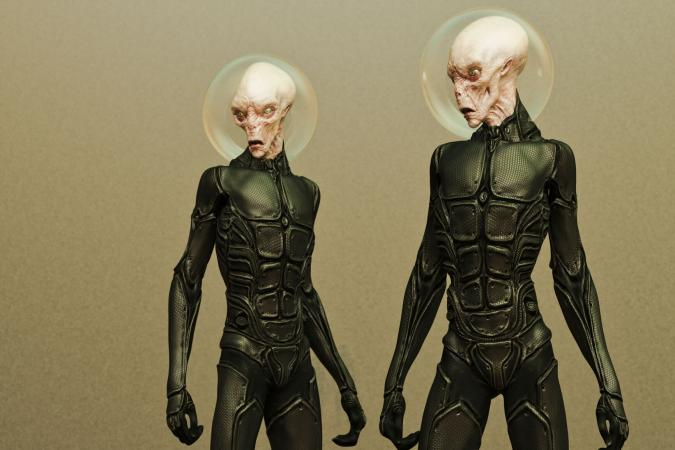 Two aliens in black spacesuits