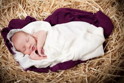 Baby swaddled in purple cloth