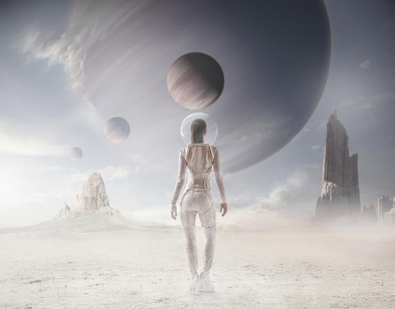 Woman in spacesuit looking at planets