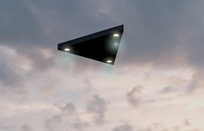 Triangular shaped ufo flying in the sky