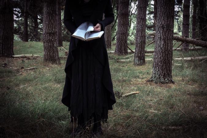 Bizarre Woman Reading A Book In The Forest