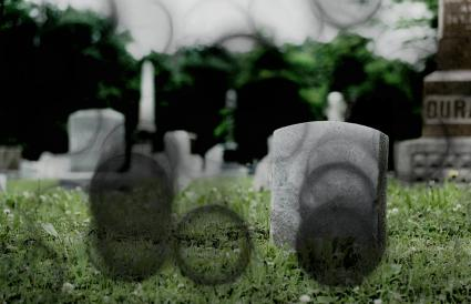 black orbs over a gravesite