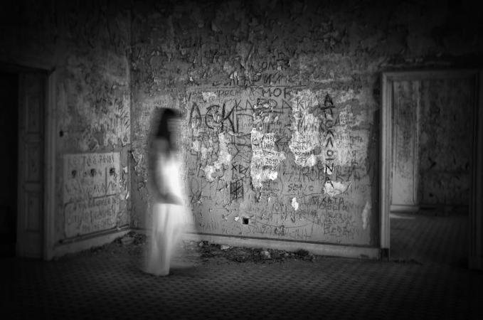 Blurred motion of woman walking