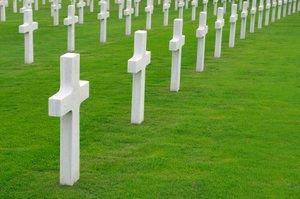 A military graveyard with rows of crosses
