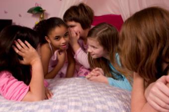 Girls telling secrets