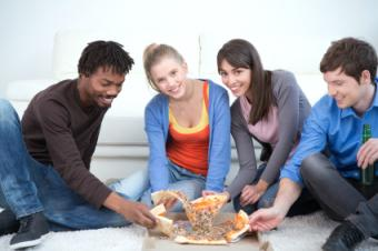adults eating pizza