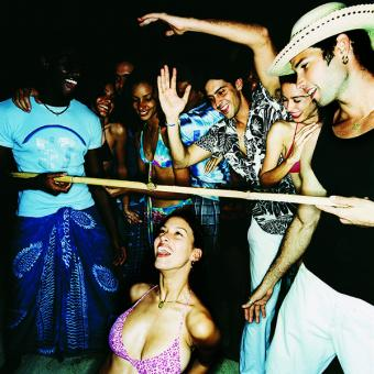 People doing the limbo at a party