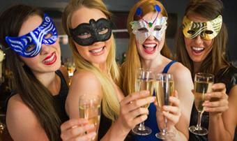 Friends wearing party masks