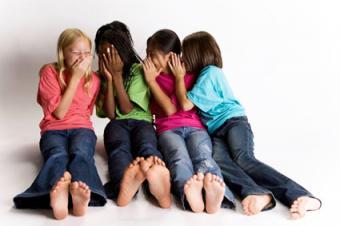 Girls playing Telephone Line