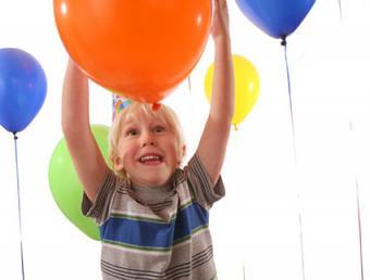 Boy playing Balloon Catch