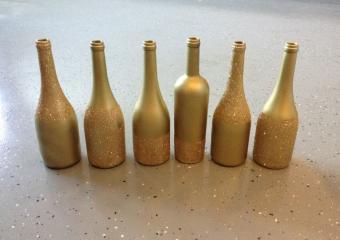 Gold glitter wine bottles