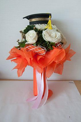 floral mortarboard centerpiece