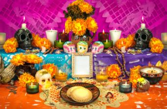Traditional Mexican Day of the dead altar with sugar skulls