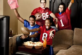 Football fans at home watching the game