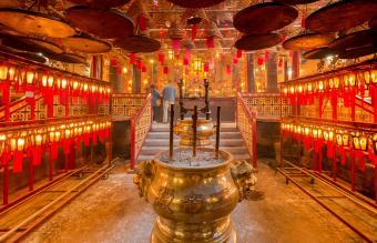 praying inside the Man Mo temple