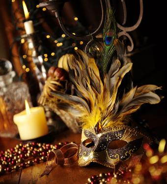 Feathered masquerade mask and peacock feather table decor