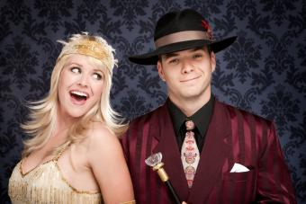 Woman and man dressed as flapper and gangster