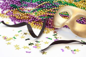 Gold Carnival mask with beads in Mardi Gras colors