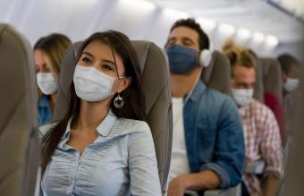 Woman traveling wearing a facemask