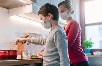 cooking at home wearing facemask