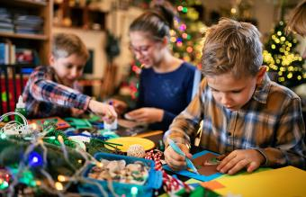 Family crafting Christmas cards
