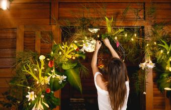 Woman decorating door for Christmas