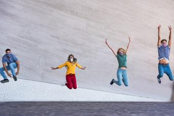 Young people jumping dancing outdoor during coronavirus outbreak