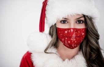 female Santa wearing a Christmas facemask