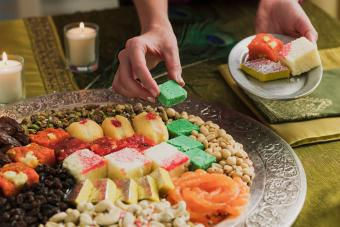 Person with platter of Diwali sweets