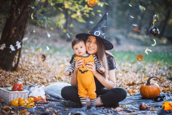 Mother and son at park on picnic during Halloween