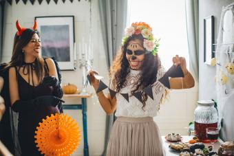 two women decorating house for halloween party