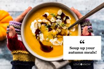 Girl's hands holding bowl of creamed pumpkin soup