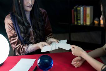 woman tarot card reading at adult halloween party