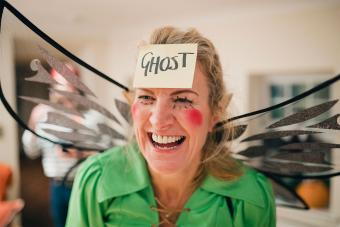 woman fairy costume sticky note forehead ghost