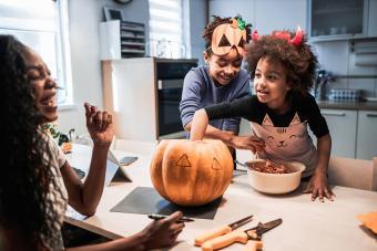 family making Jack-O'-Lantern for halloween