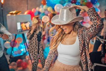 Woman with cowboy hat at new year's eve party