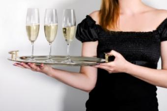 woman with tray full of cocktails