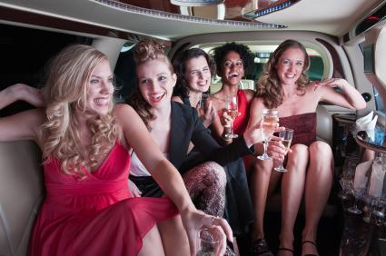 Bride-to be with friends in a limo