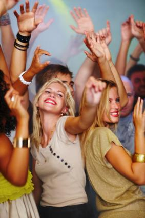 College students partying; copyright Yuri Arcurs at Dreamstime.com