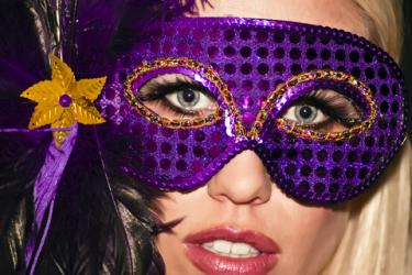 Mardi Gras party goer; copyright Daniel Raustadt at Dreamstime.com