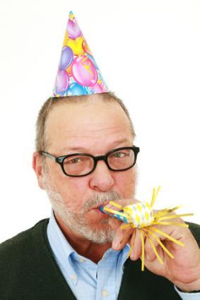 Senior celebrating his 60th birthday; copyright Isabel Poulin at Dreamstime.com