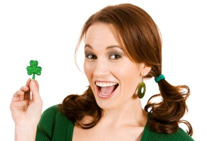 woman holding shamrock