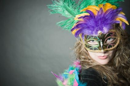 Woman wearing a Mardi Gras mask
