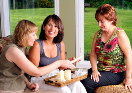 Women playing candle party game